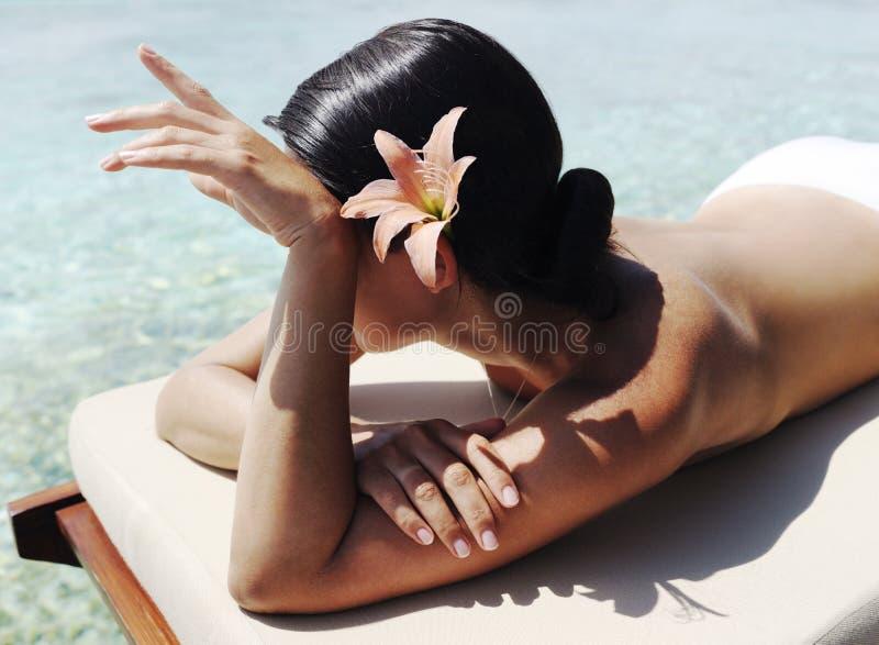 Beautiful woman taking sunbath stock photography