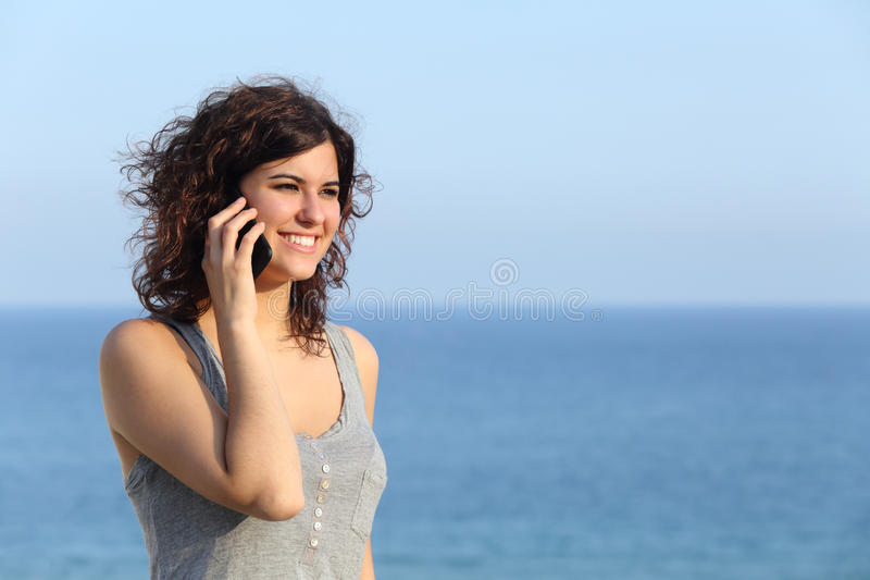 Beautiful woman talking on the mobile phone