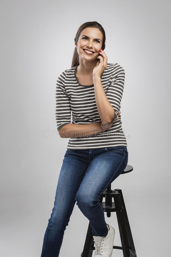 Beautiful woman talking on phone stock images
