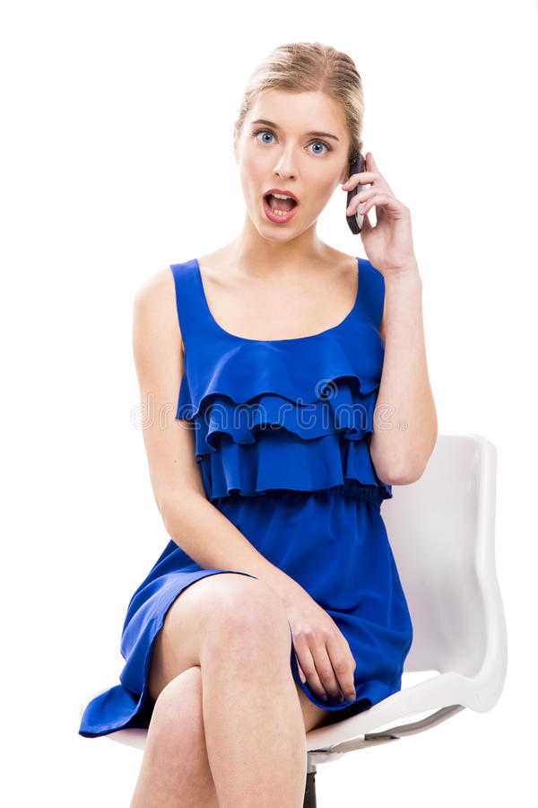 Beautiful woman talking by phone stock images