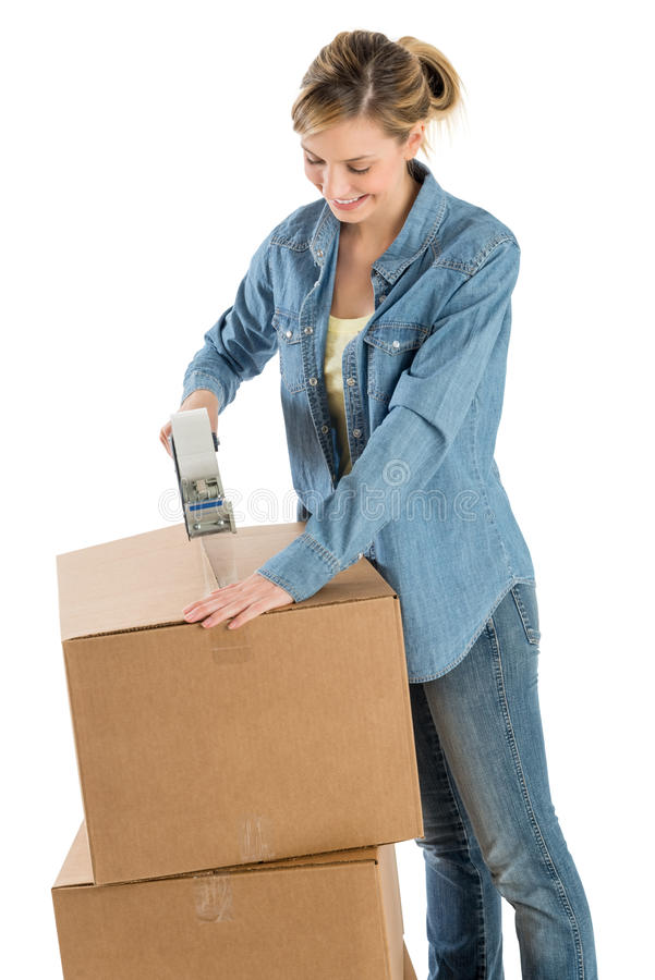 Beautiful Woman Taping Cardboard Boxes royalty free stock photography