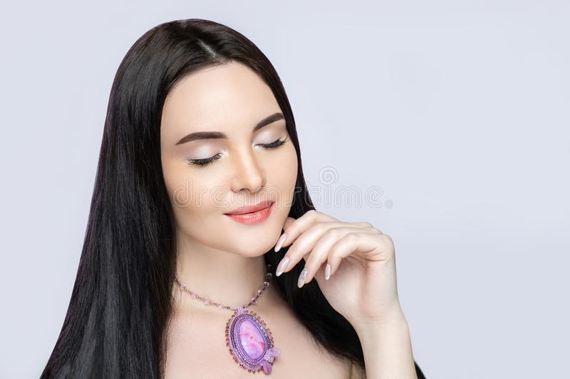 Beautiful woman tender touch smile royalty free stock photography