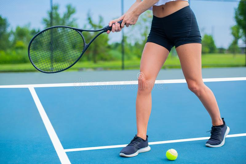 Beautiful woman with tennis racket on tennis court royalty free stock images