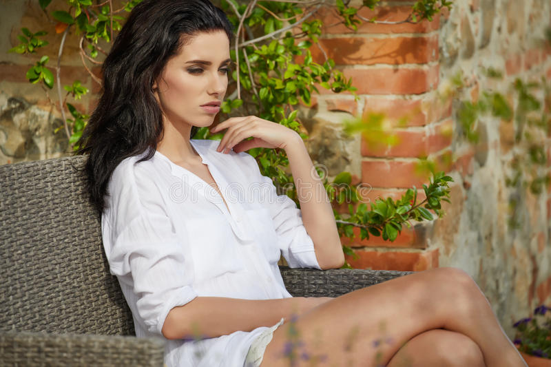 Beautiful woman on the terrace of an Italian country garden.  royalty free stock image