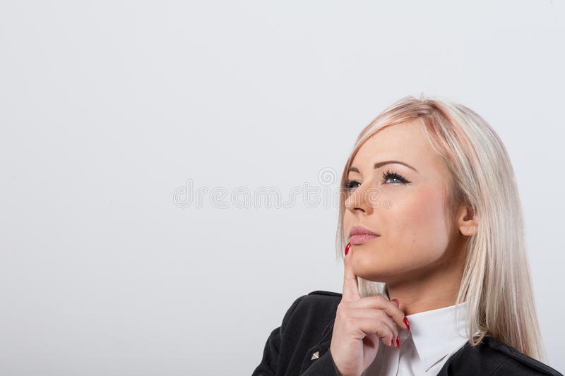 Beautiful woman thinking about COPY SPACE royalty free stock photography