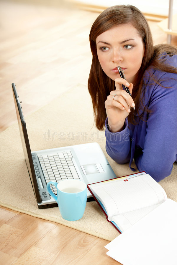 Beautiful woman thinking in home stock images