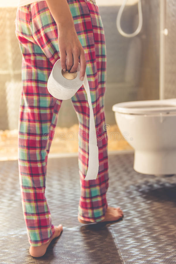 Beautiful woman in toilet royalty free stock photography