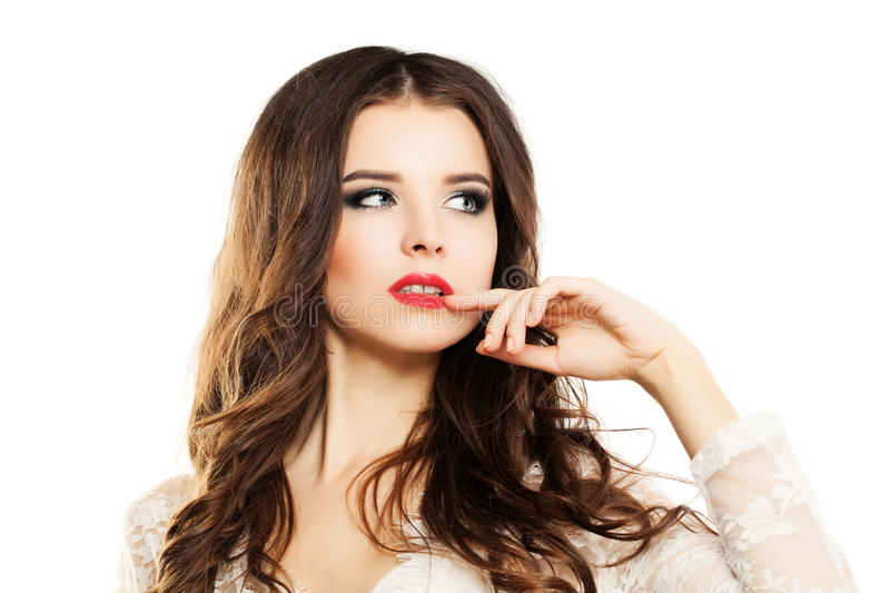 Beautiful Woman Touches her Hand on her Lips stock images