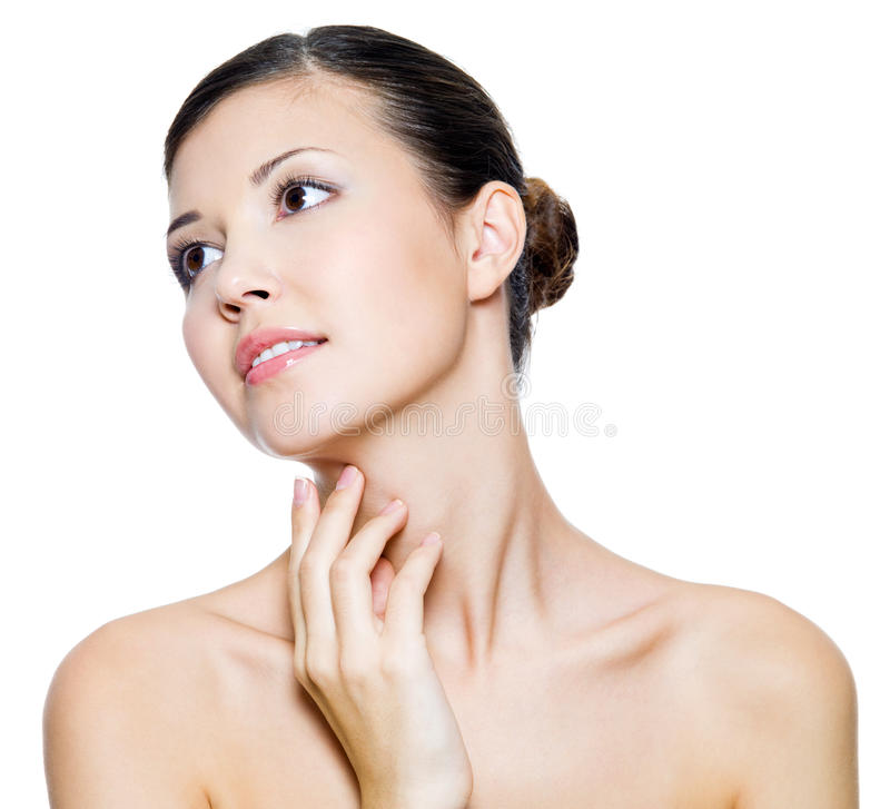 Beautiful woman touching by fingers her neck royalty free stock image