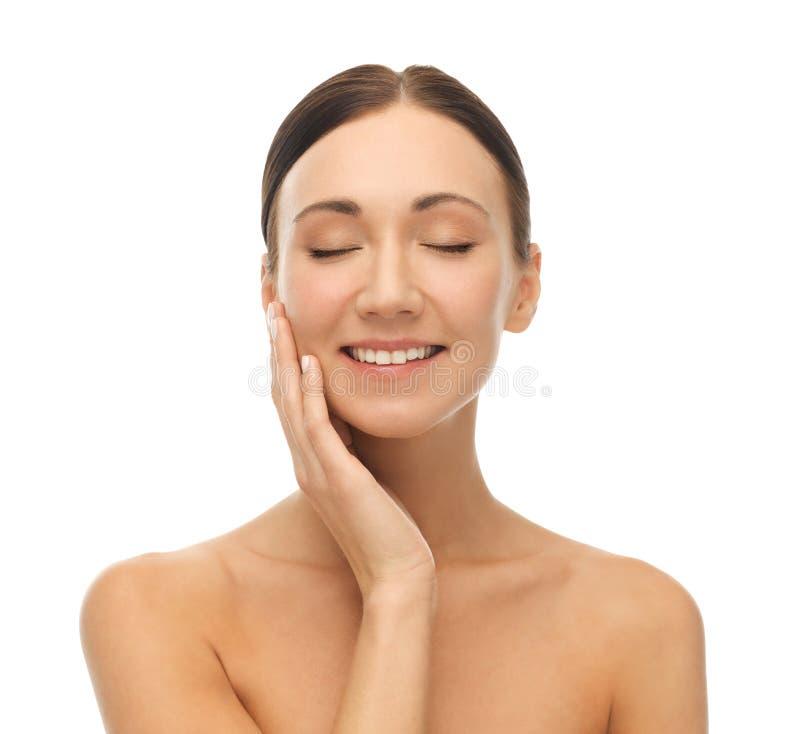 Beautiful woman touching her skin royalty free stock photos