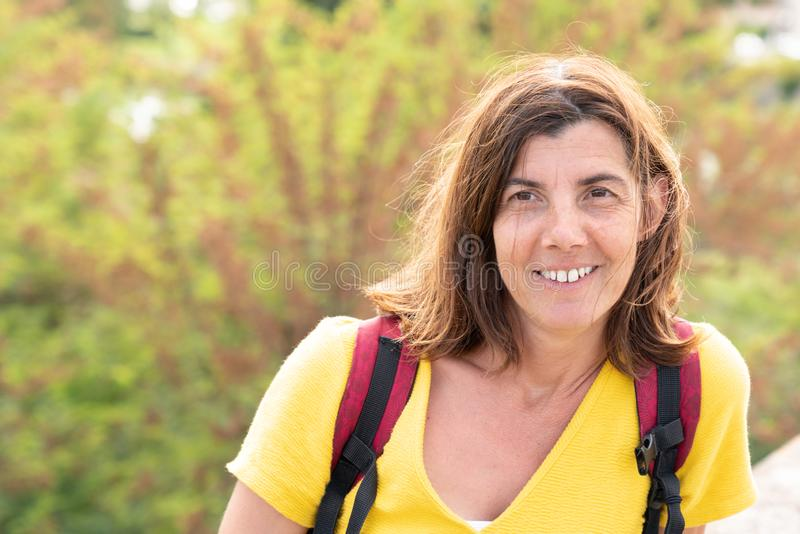 Beautiful woman tourist in park street happy laughing royalty free stock photo