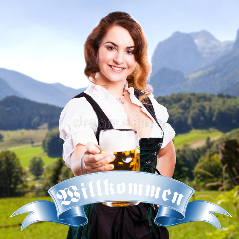 Beautiful woman in a traditional bavarian dirndl stock photography