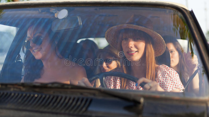 Beautiful woman traveling with her friends stock images