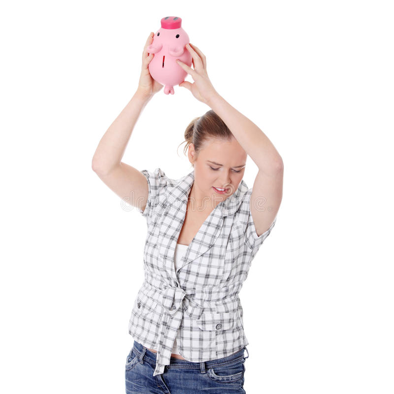 Download Beautiful Woman Trying To Get Money From Her Piggy Stock Image - Image: 18531373