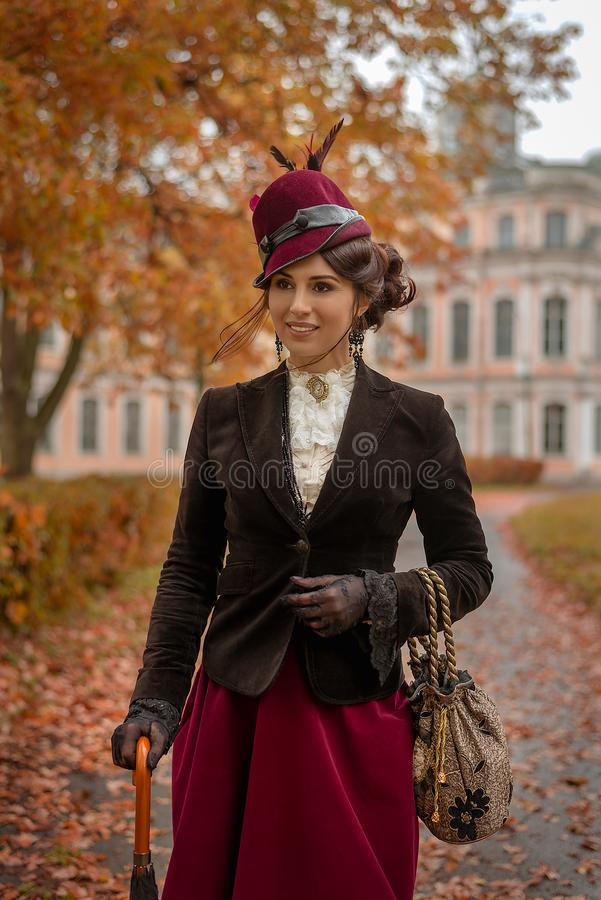 Beautiful woman with umbrella in the park royalty free stock photography