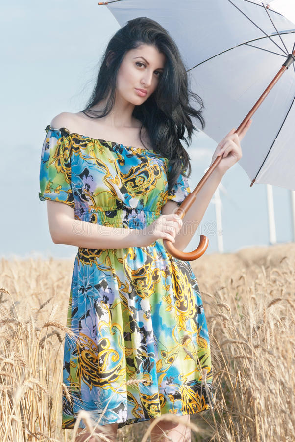Beautiful woman with umbrella in the Rye stock photos