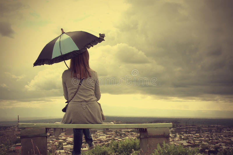 Beautiful woman with the umbrella royalty free stock photography