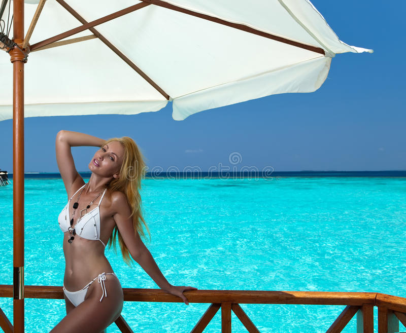 Download The Beautiful Woman Under Parasol Near The Sea Stock Image - Image: 25184281