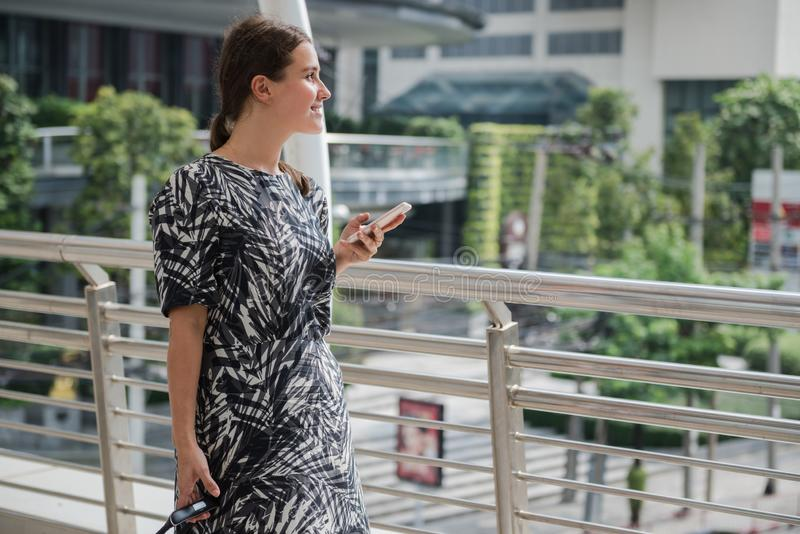 A beautiful woman used smartphone as GPS while walking in the city stock images
