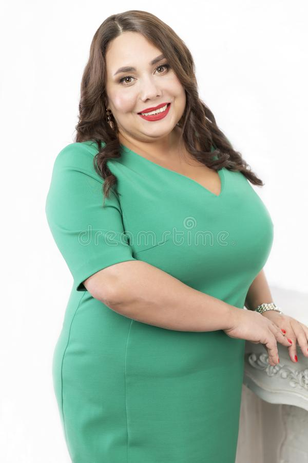 Beautiful woman with very big breasts. Isolated on white background royalty free stock photography