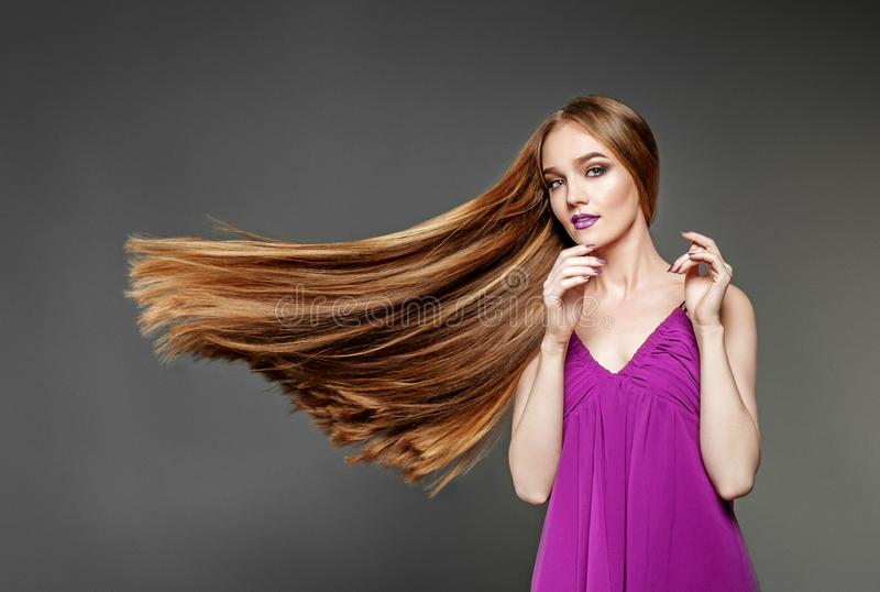 Beautiful woman with a very long, healthy hair. The concept mode royalty free stock image