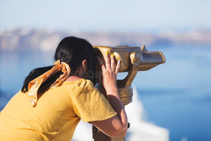 Beautiful woman viewing amazing seascape through binoculars stock photos