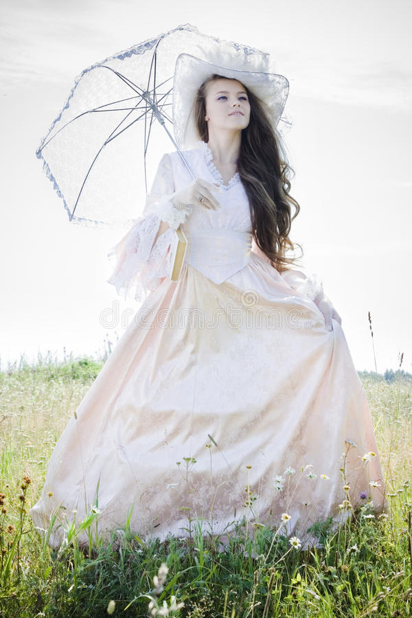Beautiful woman in vintage dress stock images