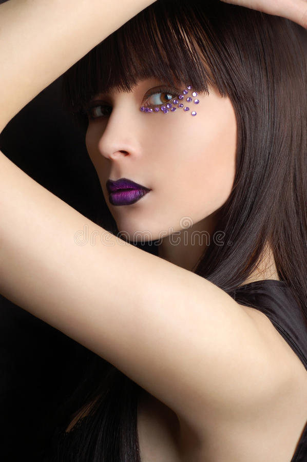 Beautiful woman with violet make-up royalty free stock image