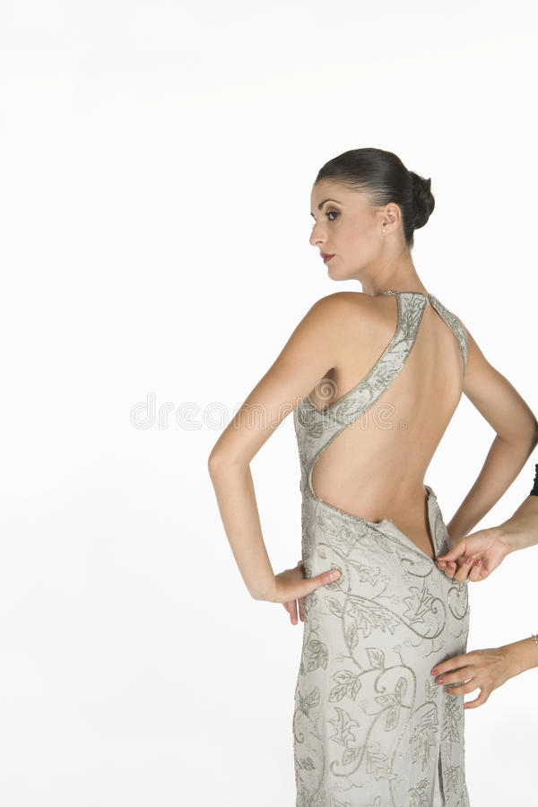 Download Beautiful Woman Waiting For Zip To Be Done Up On Backless Dress Stock Photo - Image: 33833888