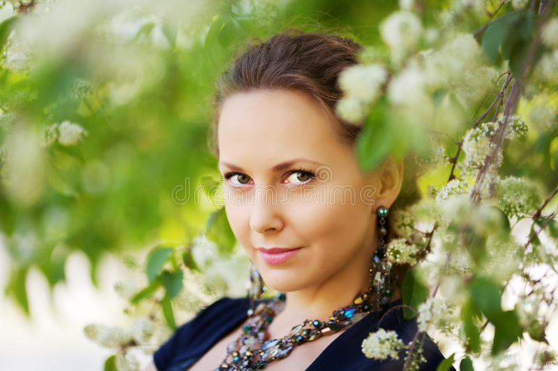 Beautiful woman in a spring garden stock photos
