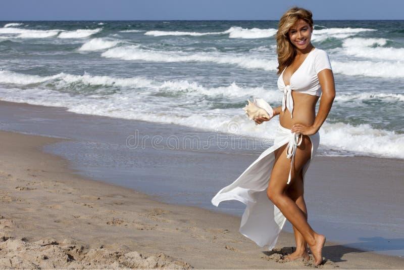 Beautiful woman walking on beach stock photos