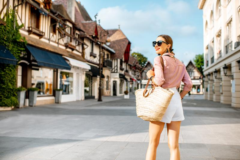 Woman traveling in Deauville city, France. Beautiful woman walking at the old town of Deauville, famous french resort in Normandy royalty free stock photography