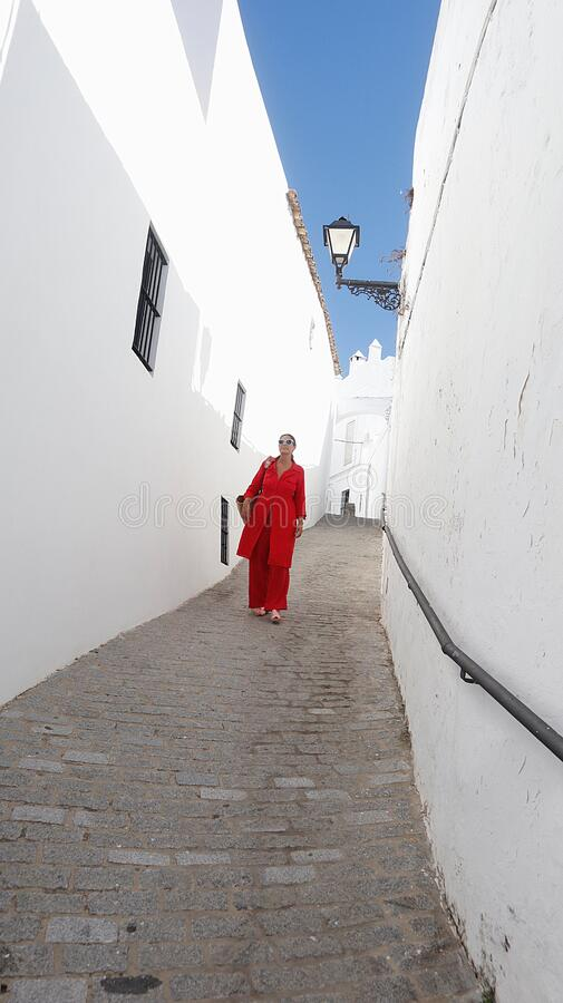 Beautiful woman walking by the streets of Vejer de la Frontera royalty free stock photo