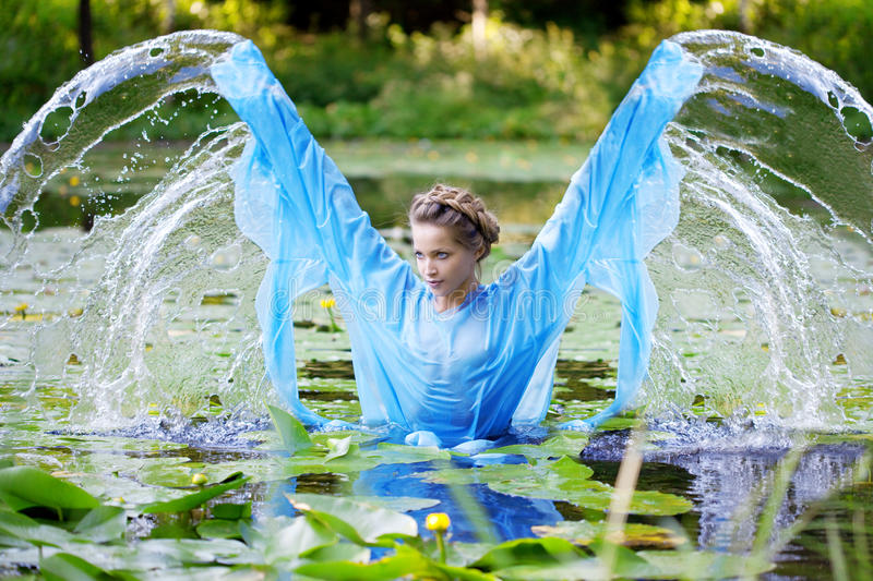 Beautiful woman and water. Beautiful woman against the background of nature and water royalty free stock image