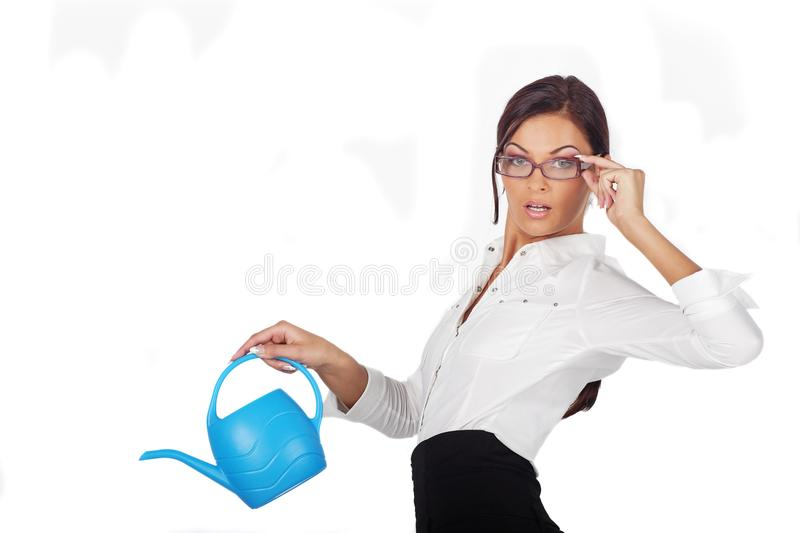 Beautiful woman with a watering can stock photography