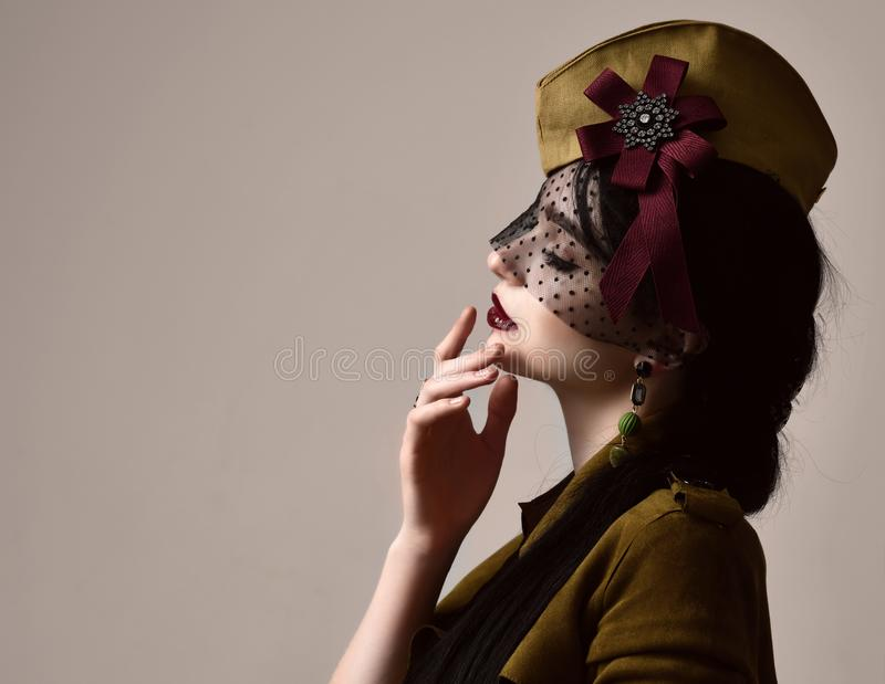 Beautiful woman wear fashion military cloth dark green hat uniform on holiday day of victory May 9 Russia stock photography