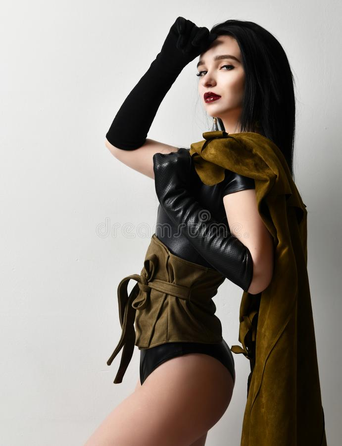 Beautiful woman wear fashion military cloth dark green jacket uniform on holiday day of victory May 9 Russia royalty free stock photo