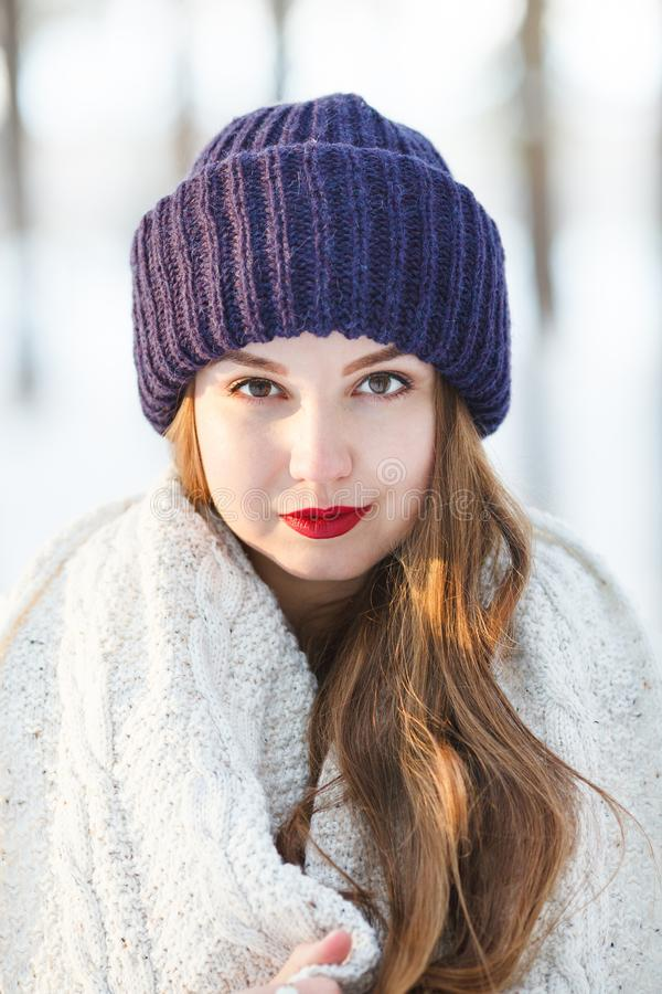 Beautiful woman wearing big knitted blue hat and scarf stock photography