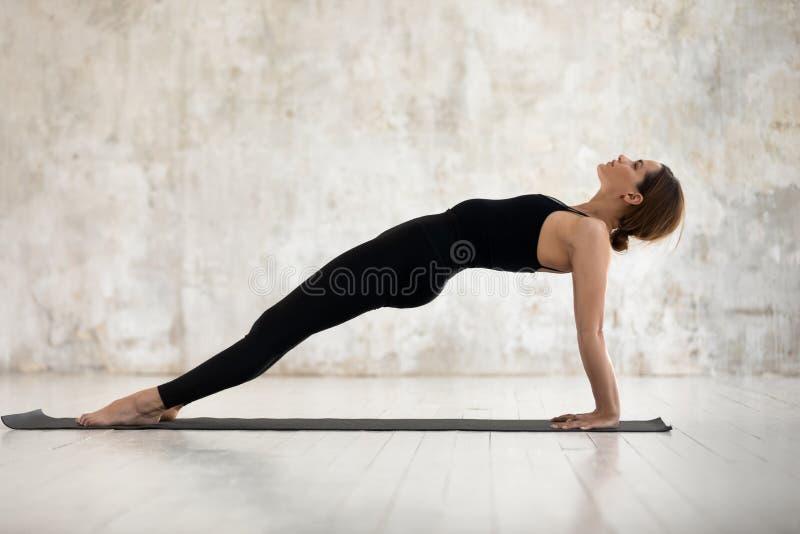 Beautiful woman practicing yoga, Purvottanasana, Upward Plank exercise royalty free stock photo