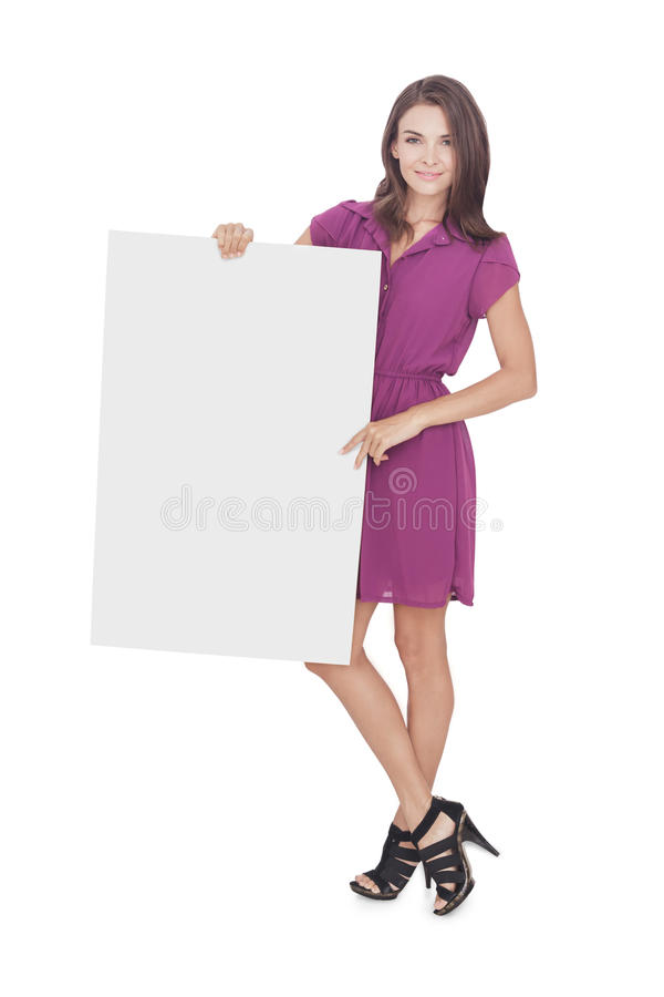 Beautiful woman wearing casual dress holding blank board royalty free stock photo