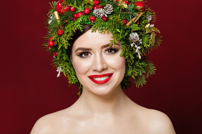 Beautiful woman wearing Christmas decorations on red background stock images