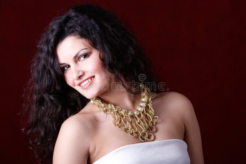 Beautiful woman wearing elegant necklace stock photography