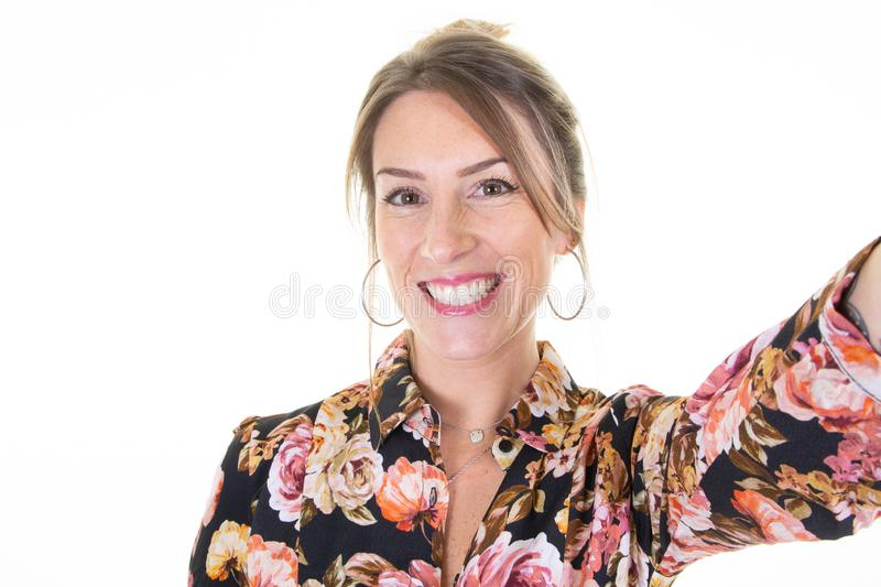 Beautiful woman wearing flowers shirt make selfie by phone camera over isolated white background smiling cheerful royalty free stock images
