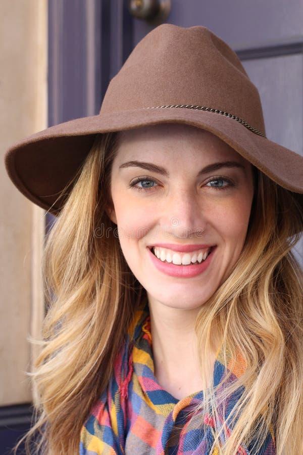 Beautiful woman wearing hat royalty free stock photography