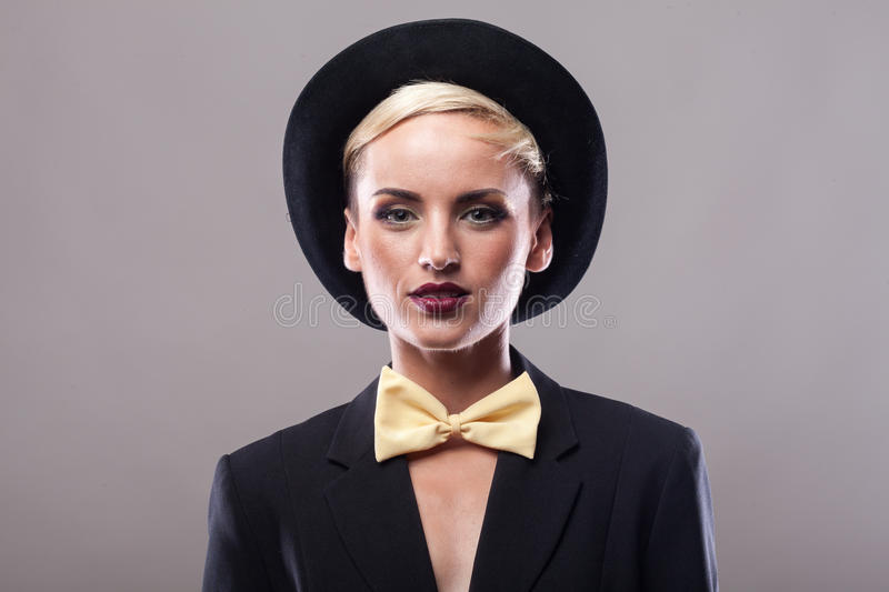 Beautiful woman wearing hat on gray background stock photos