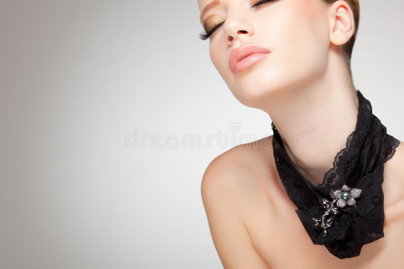 Beautiful woman wearing jewelry, clean image stock images