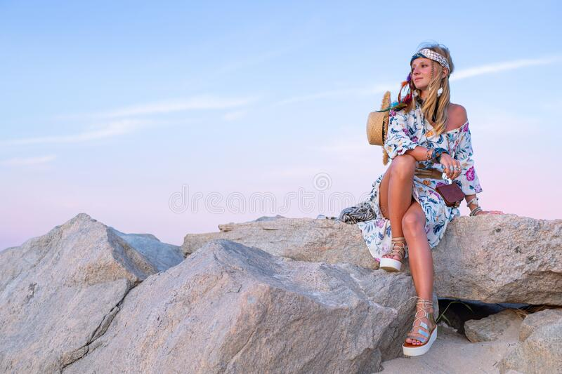 Beautiful woman wearing long dress and accessories boho style. Bohemian style girl on the beach. Beautiful woman wearing long dress and accessories boho style royalty free stock photos