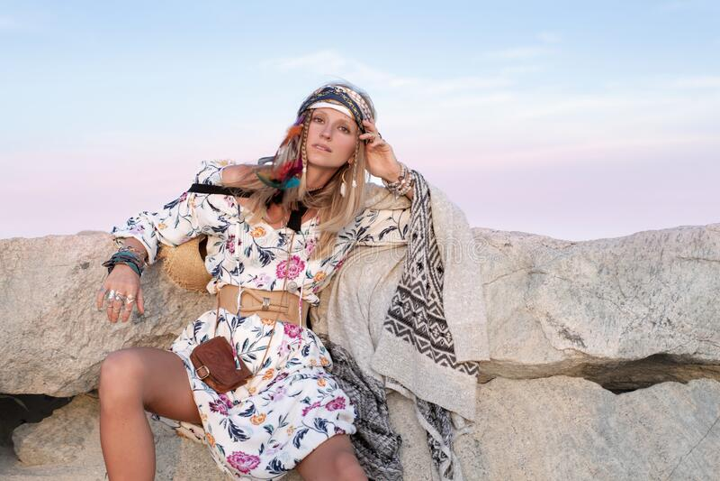 Beautiful woman wearing long dress and accessories boho style. Bohemian style girl on the beach. Beautiful woman wearing long dress and accessories boho style stock photography
