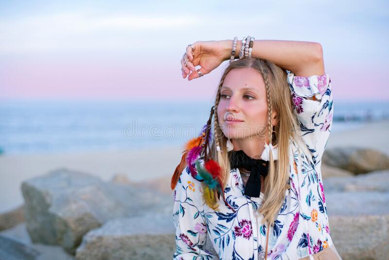 Beautiful woman wearing long dress and accessories boho style. Bohemian style girl on the beach. Beautiful woman wearing long dress and accessories boho style stock photos