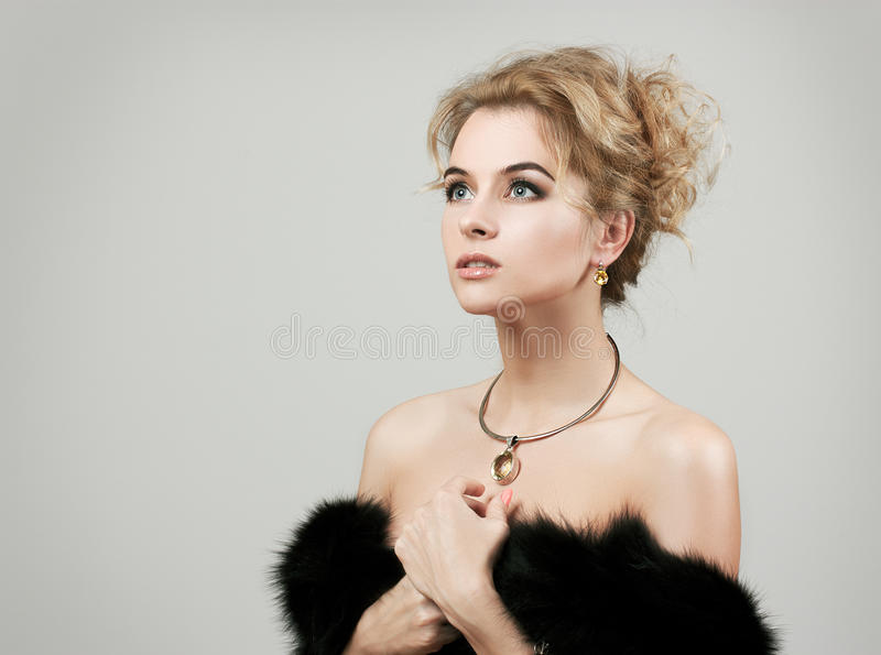Beautiful Woman Wearing Luxury Fur Coat royalty free stock photos